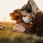 Dog and masked owner